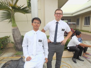 Elder Tyler Burbidge with his companion, Elder Tumanguil, prior to a baptism.